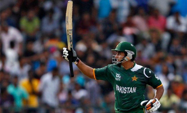 Pakistan\'s Nasir Jamshed raises his bat after scoring a half century against New Zealand...