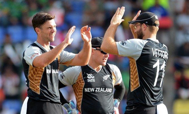 New Zealand bowler James Franklin (L) celebrates the wicket of Pakistan cricket captain...