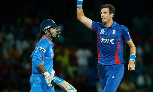 England\'s bowler Steven Finn celebrates the wicket of Irfan Pathan...