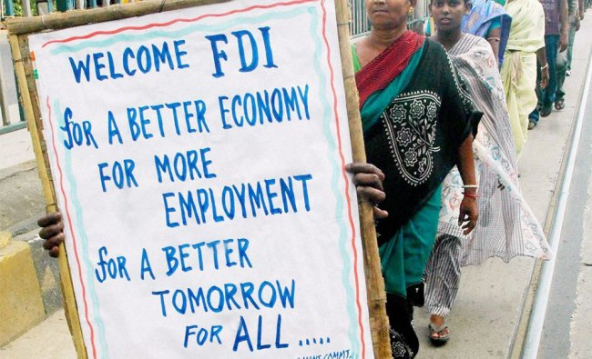 West Bengal Pradesh Congress activists participate in a rally supporting FDI...