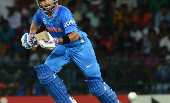 Virat Kohli runs between the wicket during the match against England...