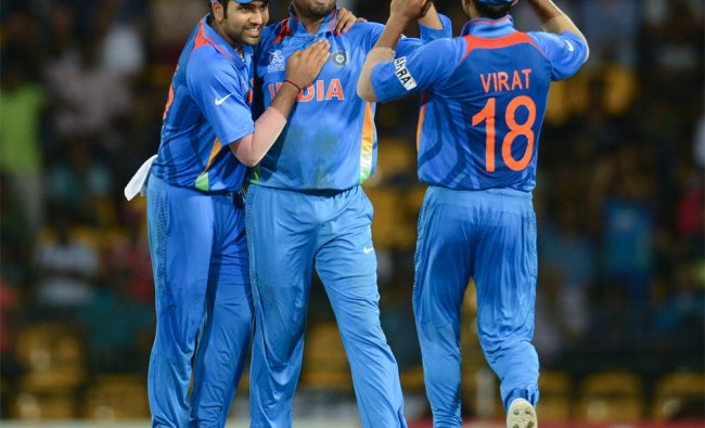 Harbhajan Singh is congratulated after dismissing England\'s Jos Buttler...