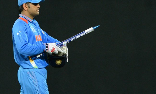 Dhoni walk with a stump after India won the T20 match against England...