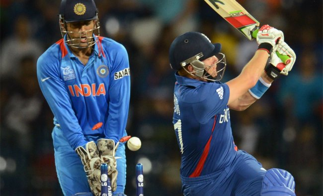 Jonny Bairstow is bowled as Mahendra Singh Dhoni looks on...