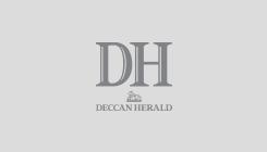 Rhinoceros stands in the flood water at Kaziranga wildlife sanctuary East of Guwahati