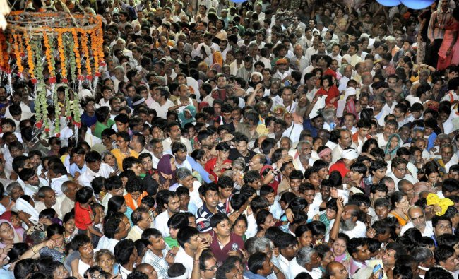 Devotees throng to pay obesiance to goddess Radha at Sri Ji temple premises