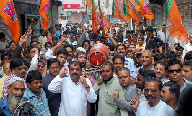 BJP activists taking out protest rally against Union Government over FDI in multi-brand retail...