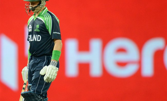 Ireland\'s William Porterfield leaves the field after being bowled by West Indies\' Fidel Edwards ...