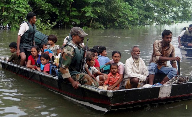 Indian army soldiers rescue flood victims in Sonitpur district of Assam...