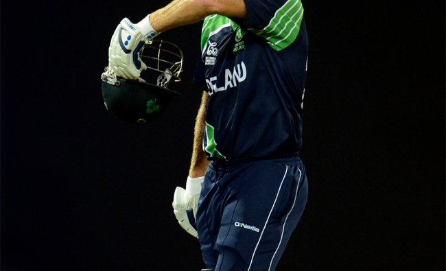 Ireland\'s Trent Johnston leaves the field at the end of the innings...
