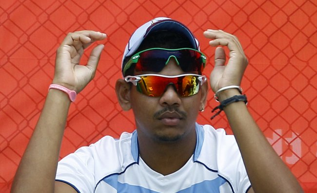 Sunil Narine waits to bowl in the nets during a training session