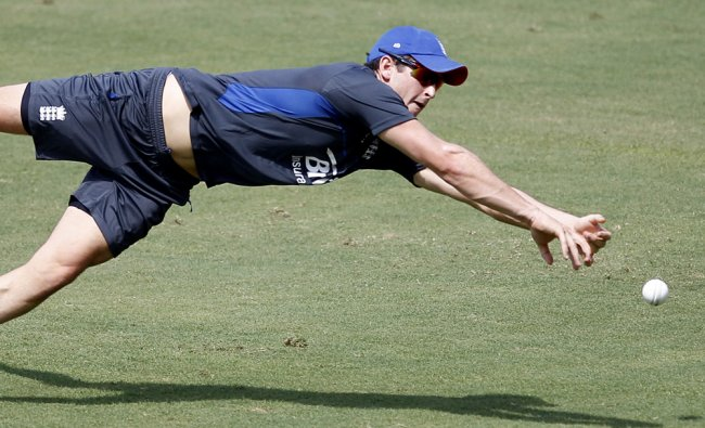 Craig Kieswetter dives to catch the ball during a training session