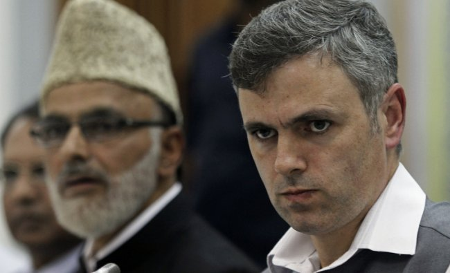 Omar Abdullah gestures during a press conference in Srinagar