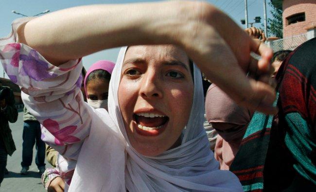 A Kashmiri paramedic student shouts slogans during a protest in Srinagar, India