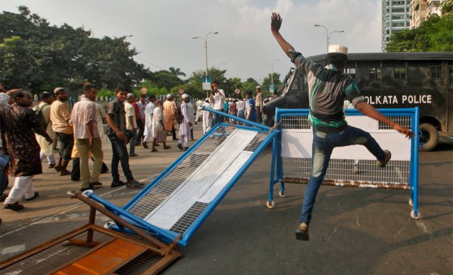 A Muslim demonstrator during a protest against a film they consider blasphemous to Islam in Kolkata.
