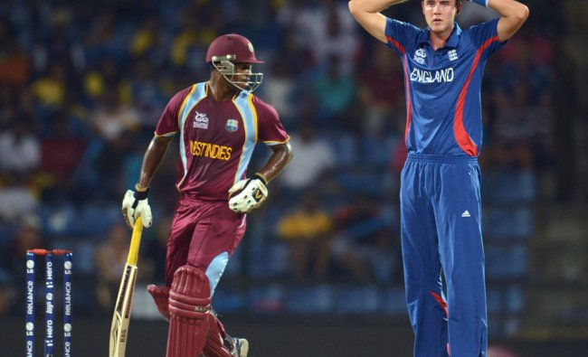 England\'s captain Stuart Broad reacts as West Indies\' Johnson Charles looks on...