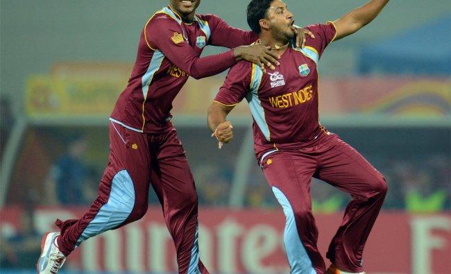 West Indies\' Ravi Rampaul celebrates with Marlon Samuels after dismissing Luke Wright...