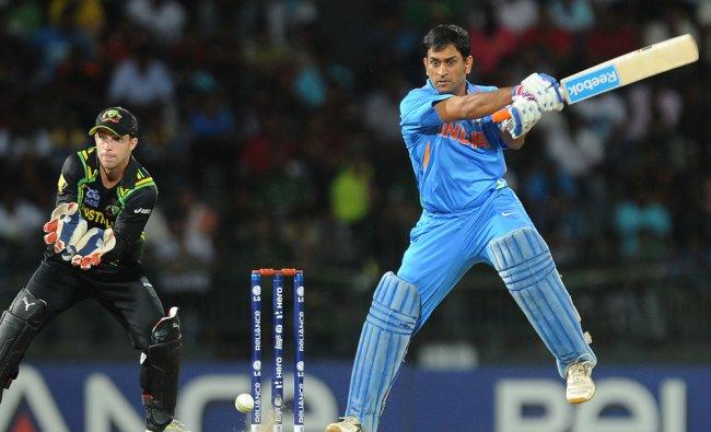 Mahendra Singh Dhoni (R) plays a shot