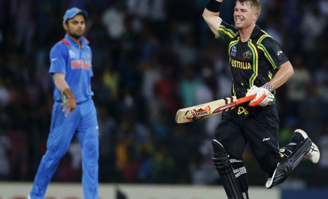 David Warner celebrates his team\'s victory over India
