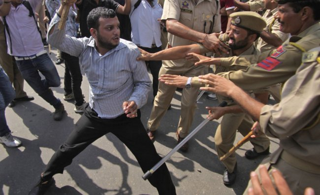 Policemen tussle with activists of the Indian Youth Congress during a protest rally in Jammu