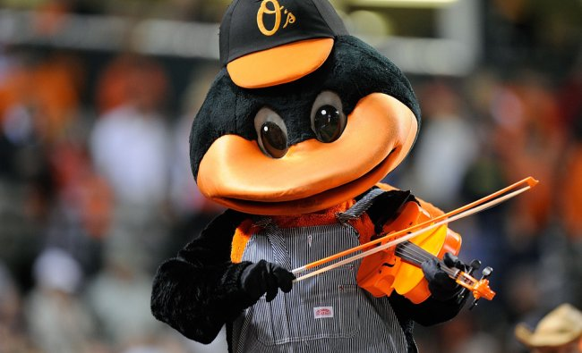 The Orioles mascot perfroms during the seventh inning stretch of the game