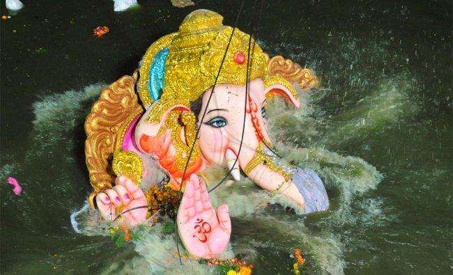 An idol of the elephant-headed Hindu God Ganesh is immersed into the Hussain Sagar Lake in Hyderabad