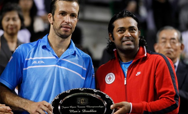 Radek Stepanek of the Czech Republic (L) and Leander Paes of India pose with their runner-up trophy
