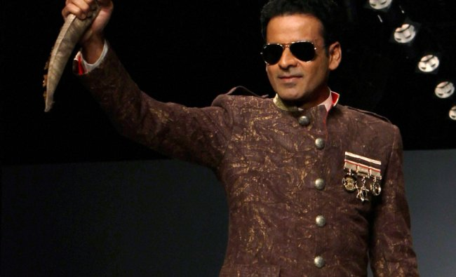 Manoj Vajpai displays creation of Samant Chauhan during the Wills Lifestyle India Fashion Week