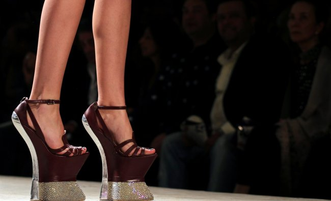 A model presents a creation from Dutch designer Jan Taminiau\'s Spring/Summer 2013 collection