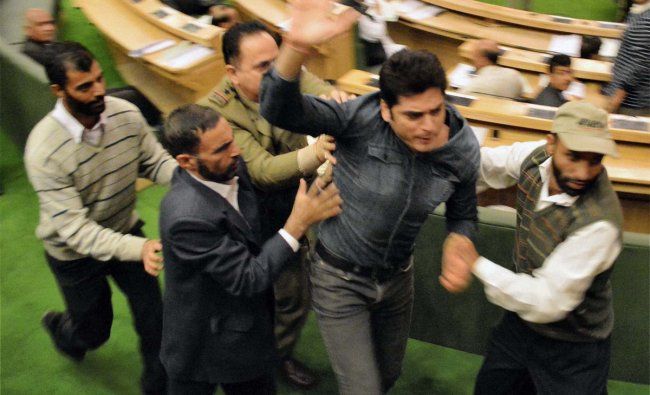 Watch and Ward staff taking away an identified youth who entered J&K Assembly and shouted slogans