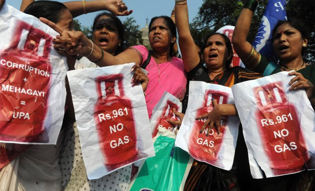 Indian residents shouts slogans during a protest against the rise in the price of cooking gas
