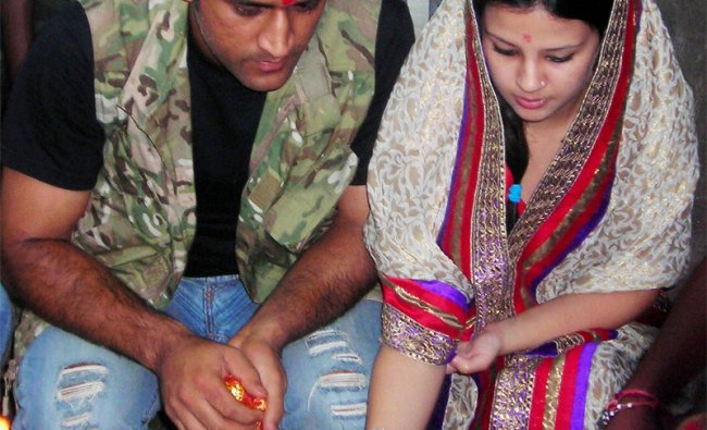 Indian captain M S Dhoni along with his wife Sakshi worship at Deori temple at Tamar