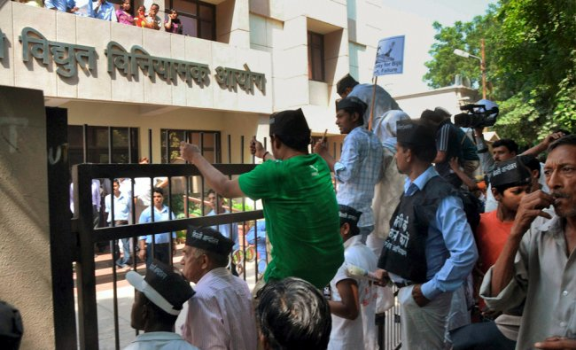 IAC and BJP activists gather outside the office of Delhi Electricity Regulatory Commission