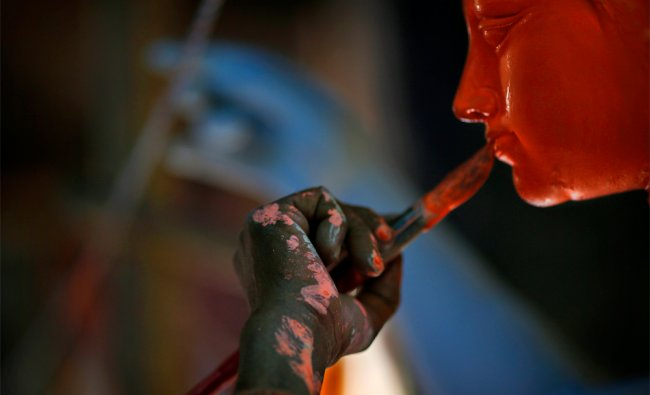 An artist paints idols of Hindu warrior goddess Durga, who destroys demons to prevail over evil...