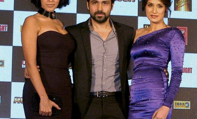 Actors Emraan Hashmi, Neha Dhupia and Sagarika Ghatge at a press meet for their new film \'Rush\'...