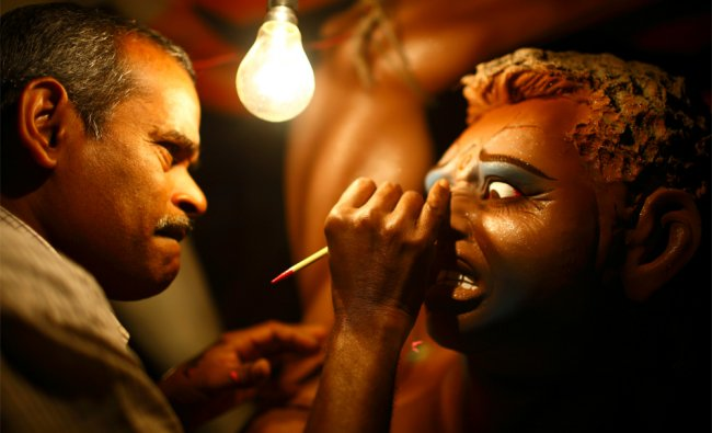 An artist gives the finishing touches to an idol of demon Mahishasura ahead of Dashain festival...