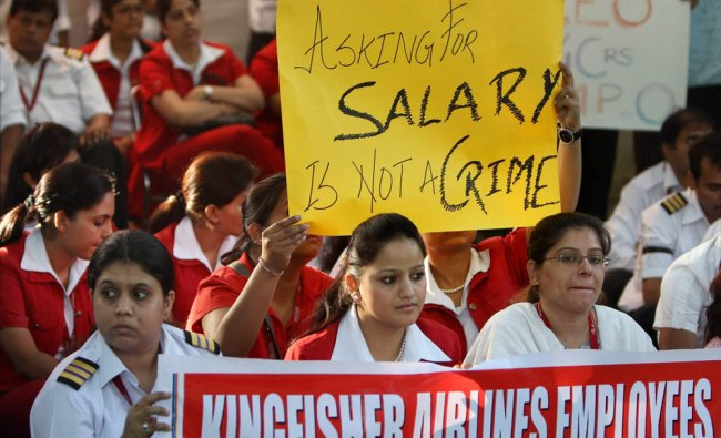 Kingfisher employees showing banner and placards during a dharna at Jantar Mantar in New Delhi on...
