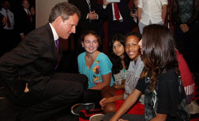 US Treasury Secretary Timothy Geithner interacts with students during a visit to his former...