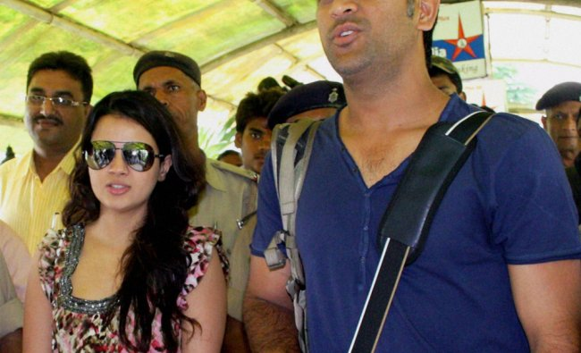 Cricketer MS Dhoni with wife Sakshi at Birsa Munda airport in Ranchi on Tuesday to catch a flight...