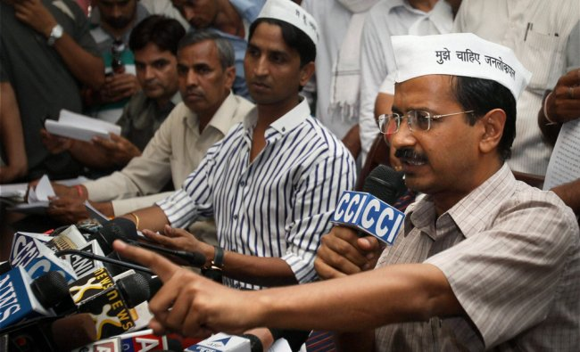 Arvind Kejriwal along with other members of India Against Corruption addressing a press...