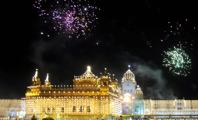 Fire crackers lit the sky over illuminated Golden Temple on the occasion of 478th birth Anniversary