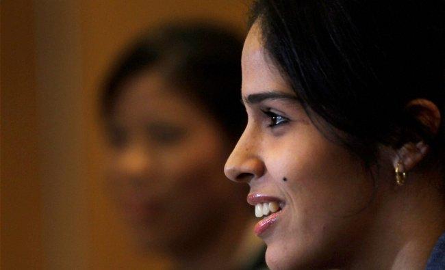 Olympic medal winner badminton player Saina Nehwal speaks after her felicitation at a press...