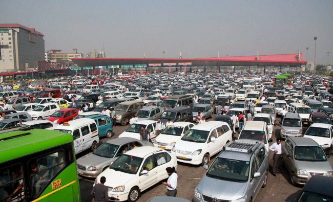 A heavy traffic jam near toll plaza after a protest by residents demanding opening of a U-turn...