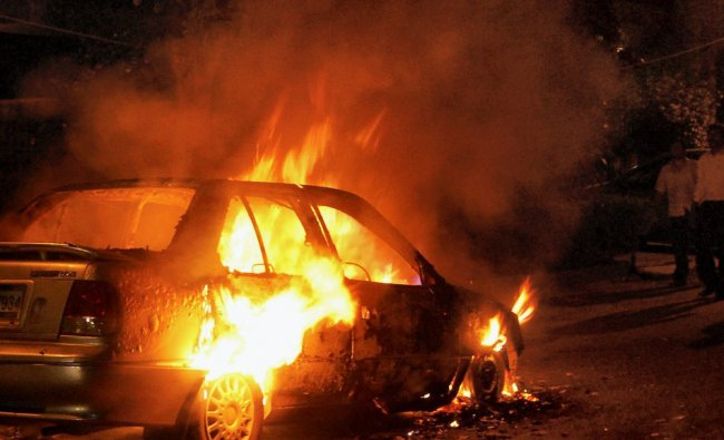 A car in flames after it catches fire in Noida