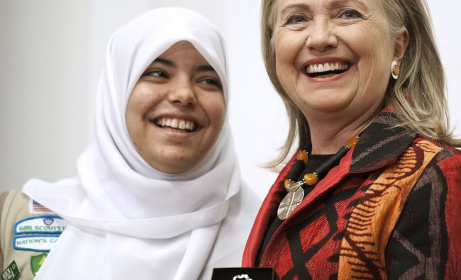 Girl Scout Abrar Omeish of Fairfax, Va., presents Secretary of State Hillary Rodham Clinton with...