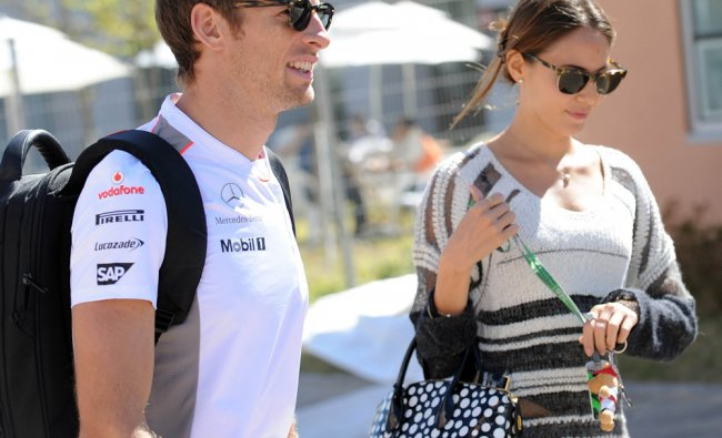 McLaren-Mercedes driver Jenson Button of Britain (L) and his girlfriend Jessica Michibata (R)...