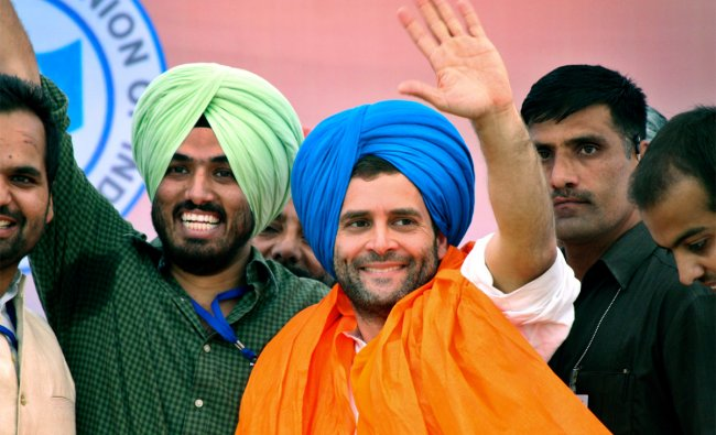 Rahul Gandhi, center, waves during an event organized by the National Students Union of India