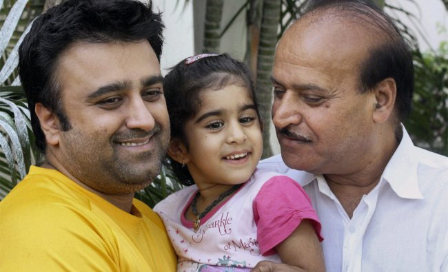 Sudhir Mahajan, the director of a cricket bat manufacturing company, with his son and grand-daughter