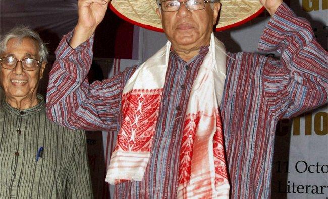 Actor Girish Karnad being felicitated with an Assamese japi during a programme in Guwahati