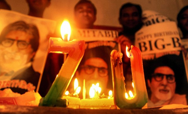 Fans of megastar Amitabh Bachchan light candles in front of his pictures